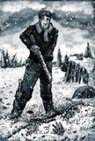 Uomo con il fucile sul terreno incolto congelato Immagini Stock