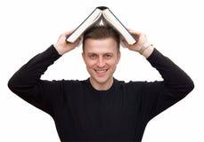 Uomo con il grande libro Fotografia Stock