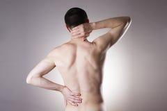 Uomo con il mal di schiena Dolore nel corpo dell'uomo Fotografie Stock