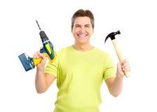 Uomo con il martello ed il trivello Fotografia Stock