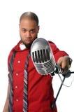 Uomo con il microfono dell'annata Fotografia Stock