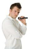 Uomo con il microfono in mani Fotografia Stock Libera da Diritti