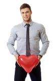 Uomo con il pallone del cuore Fotografia Stock