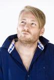 Uomo con il pensiero dei capelli biondi Fotografia Stock