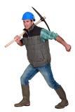 Uomo con il piccone Fotografia Stock Libera da Diritti