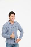 Uomo con il pollice in su Fotografia Stock