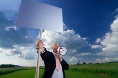 Uomo con il segno ed il megafono Fotografie Stock Libere da Diritti