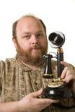 Uomo con il telefono dell'annata Fotografia Stock