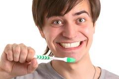 Uomo con il tooth-brush Fotografia Stock Libera da Diritti