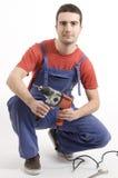 Uomo con il trivello fotografia stock