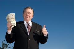 Uomo con il wad di contanti. Fotografia Stock
