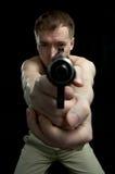 Uomo con l'arma immagini stock libere da diritti