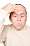 Uomo con l'emicrania Fotografie Stock Libere da Diritti