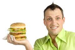 Uomo con l'hamburger Immagine Stock
