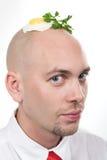 Uomo con l'uovo fritto Fotografie Stock Libere da Diritti