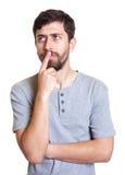 Uomo con la barba che pensa ad un problema Immagini Stock Libere da Diritti