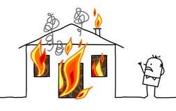 Uomo con la casa & il fuoco Fotografia Stock