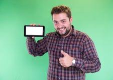 Uomo con la compressa in sua mano Fotografia Stock