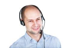 Uomo con la cuffia avricolare con un microfono di asta Fotografie Stock