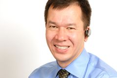 Uomo con la cuffia avricolare di Bluetooth Immagine Stock Libera da Diritti