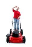 Uomo con la falciatrice da giardino rossa sopra bianco fotografia stock libera da diritti