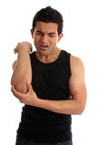 Uomo con la ferita lancinante o il dolore Immagine Stock