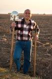 Uomo con la forcella ed il pitchfork Fotografia Stock Libera da Diritti