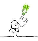 Uomo con la lampadina verde sulla barretta Fotografia Stock Libera da Diritti