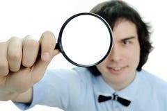 Uomo con la lente d'ingrandimento Fotografia Stock
