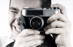 Uomo con la macchina fotografica. Fotografia Stock Libera da Diritti