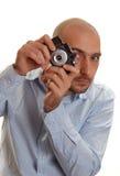 Uomo con la macchina fotografica dell'annata Immagini Stock