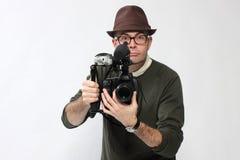 Uomo con la macchina fotografica di HD SLR Immagine Stock