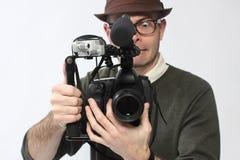 Uomo con la macchina fotografica di HD SLR Fotografie Stock Libere da Diritti