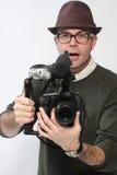 Uomo con la macchina fotografica di HD SLR Immagini Stock Libere da Diritti