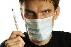 Uomo con la mascherina ed il termometro Immagine Stock Libera da Diritti
