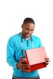 Uomo con la misura di nastro ed il contenitore di regalo Immagini Stock Libere da Diritti