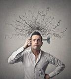 Uomo con la molla nel suo cervello Fotografie Stock Libere da Diritti