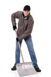 Uomo con la pala della neve Immagine Stock