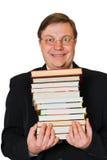 Uomo con la pila di libri Fotografie Stock