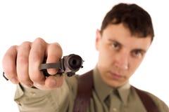 Uomo con la pistola immagini stock