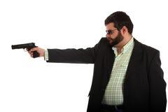 Uomo con la pistola e gli occhiali da sole Fotografie Stock Libere da Diritti