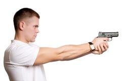 Uomo con la pistola isolata Immagini Stock