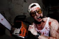 Uomo con la sega a catena Fotografie Stock Libere da Diritti