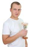 Uomo con la tazza di soldi Immagini Stock