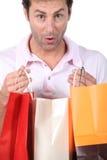 Uomo con le borse Fotografia Stock