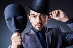 Uomo con le maschere Fotografie Stock Libere da Diritti