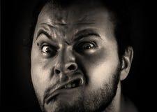 Uomo con lo smorfia Fotografia Stock Libera da Diritti