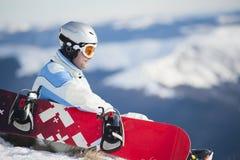 Uomo con lo snowboard Fotografia Stock Libera da Diritti