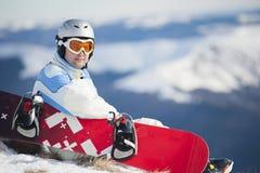 Uomo con lo snowboard Fotografia Stock