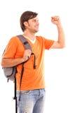 Uomo con lo zaino con la mano su Immagini Stock